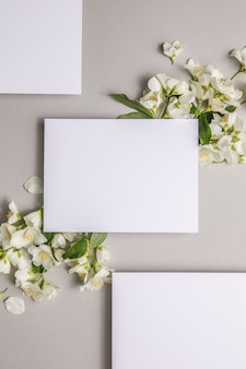 Mock up  with attached natural fresh jasmine  flowers on a gray background, copy space.