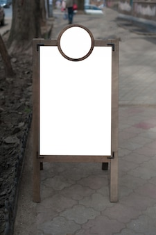 Mock up of wooden outdoor advertising stand.  place for text, poster or public information.