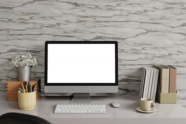 Mock up workspace with desk top computer white screen and marble wall.