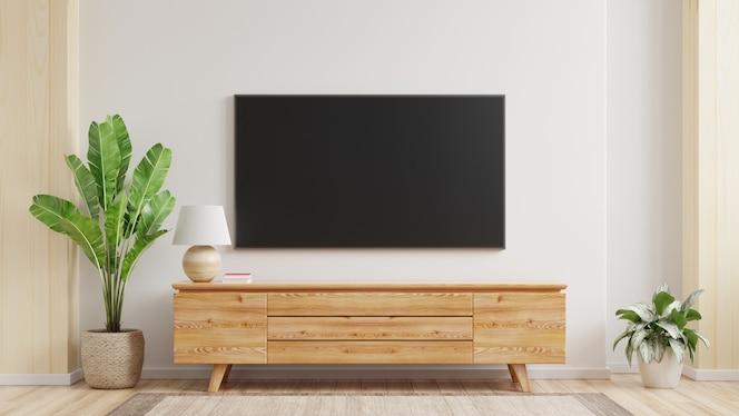 白い壁のあるリビングルームに取り付けられたテレビの壁のモックアップ。3dレンダリング