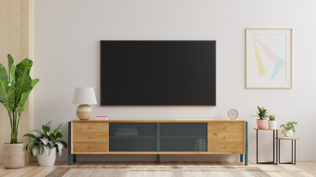 白い壁のあるリビングルームに取り付けられたテレビの壁をモックアップします。3dレンダリング