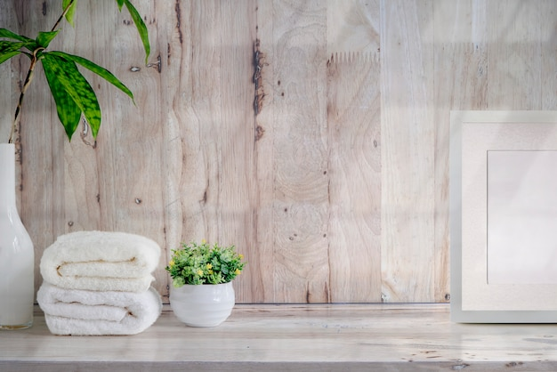 Mockup bath towels on wooden table with copy space.
