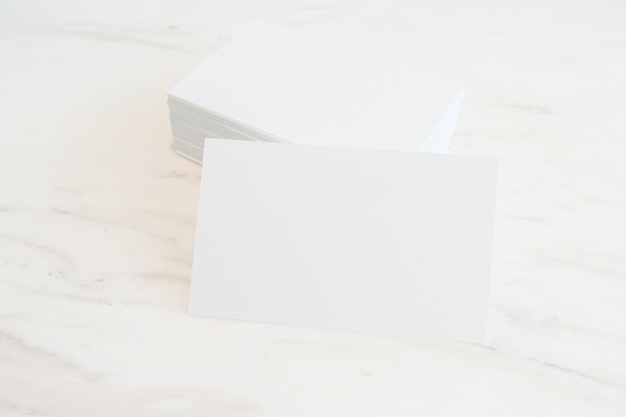 Mockup of blank business cards on marble table