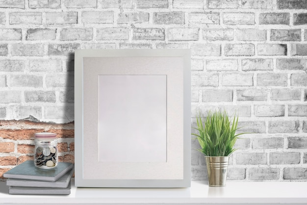 Mockup blank wooden picture frame on white table