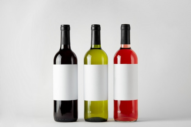 Mockup. bottles of wine of different types isolated on a white background.