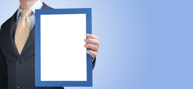 Mockup. business man holding in hands empty blank photo frame. blank diploma or certificate mockup. blank diploma or certificate mock up in businessman hand. empty photo frame border with copy space
