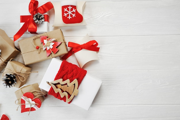 Mockup christmas boxes decorated stylishly on a white wooden