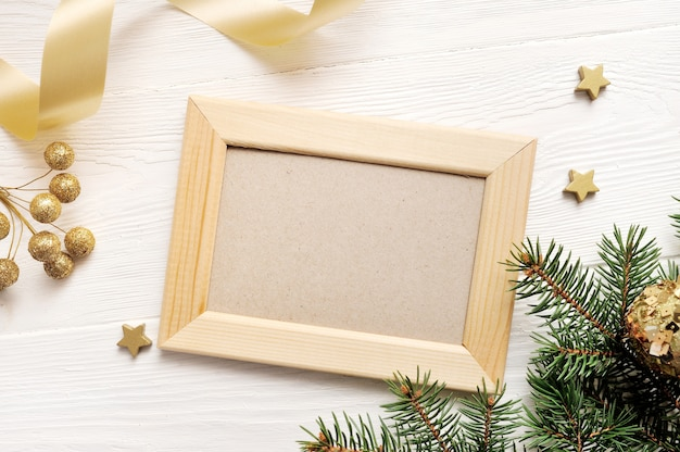 Mockup christmas greeting card top view and wood frame, flatlay on