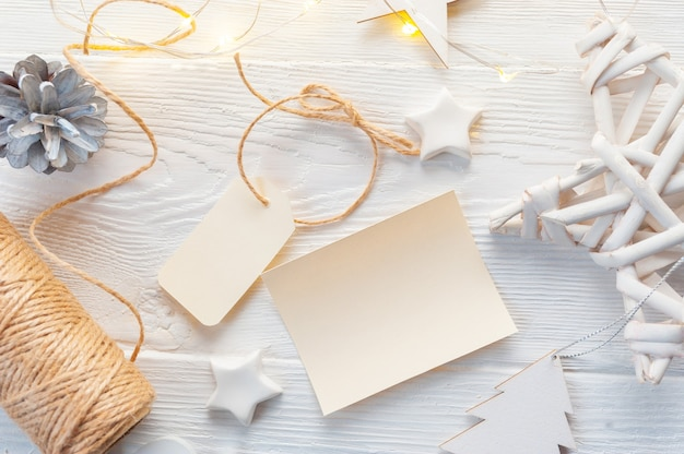 Mockup christmas kraft gift boxes with tag on wooden background.