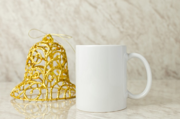 Mockup of coffee cup with christmas decoration coffee cup mockup