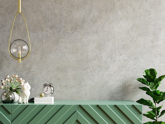 Mockup concrete wall with ornamental plants and decoration item on cabinet