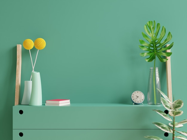Mockup dark green wall with ornamental plants and decoration item on cabinet.3d rendering