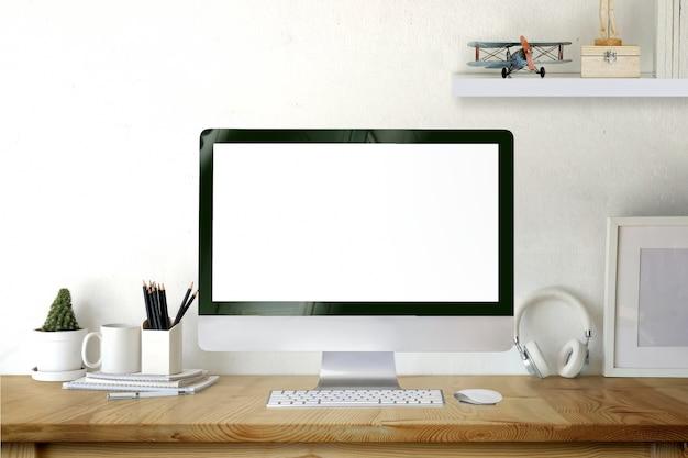 Mockup desktop computer on wooden desk.