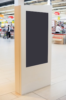 Mockup of digital white screen panel. blank  modern media billboard in the shopping center. place for text, advertising or public information.