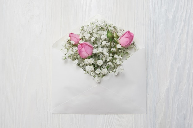 Mockup envelope with flowers and a letter, greeting card for valentines day or wedding with place for your text