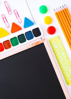 Mockup flatlay stationery chalk board on a white background of the table knolling