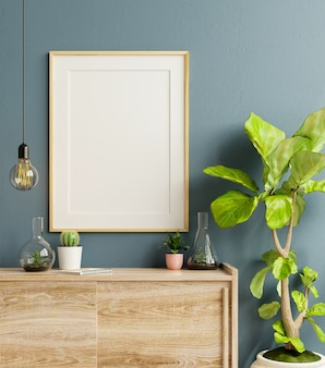 Mockup frame on cabinet in living room interior on empty dark blue wall background,3d rendering