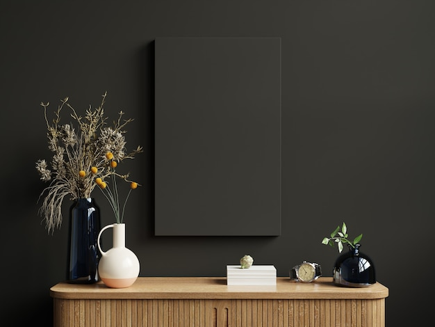 Mockup frame on cabinet in living room interior on empty dark wall background.3d rendering