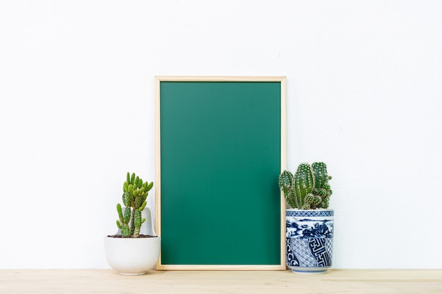 Mockup of frame poster and cactus pot, interior background