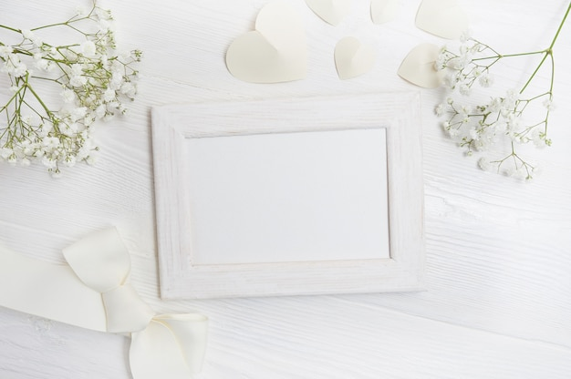 Mockup frame with flowers and bow greeting card
