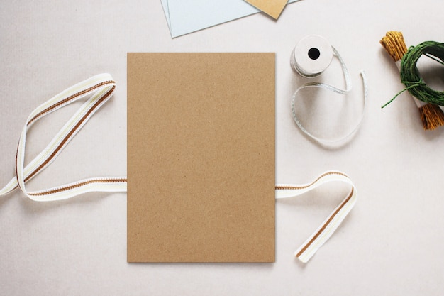Mockup image of brown paper invitation card, flat lay design