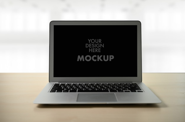 Mockup image of business laptop with blank screen on table