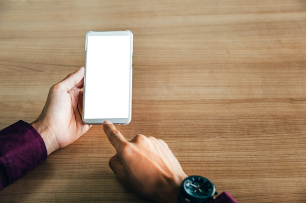 Mockup image of man's hands holding white mobile phone with blank screen technology