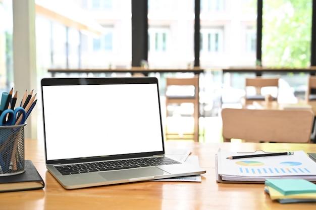 Mockup laptop computer on business office desk.
