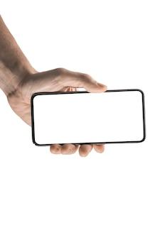 모형 휴대 전화. 남자 손을 잡고 흰색 배경에 고립 된 블랙 셀 스마트 폰. 손을 잡고 전화 whith 흰색 빈 화면을 닫습니다