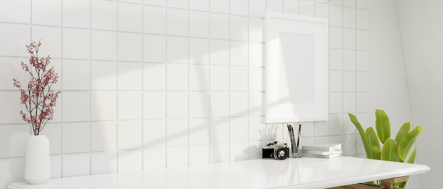 Mockup of a modern desk with home decor for montage over white tiles wall with blank poster frame