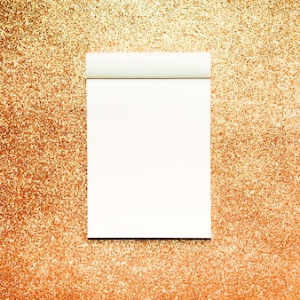 Mockup notebook with gold glitter background