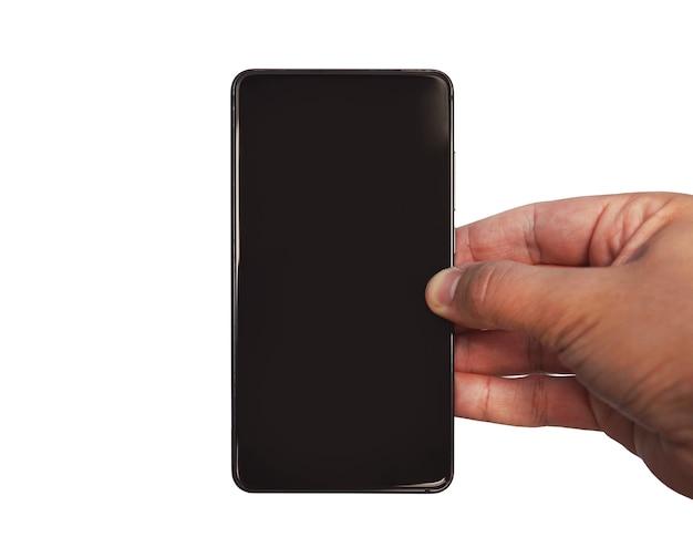 흰색 배경에 격리된 빈 화면이 있는 검은색 프레임 없는 휴대전화를 들고 있는 남성의 손을 흉내냅니다.