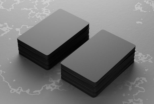 Макет бумажных визитных карточек, сложенных в две стопки на старом каменном фоне. 3d-рендеринг.