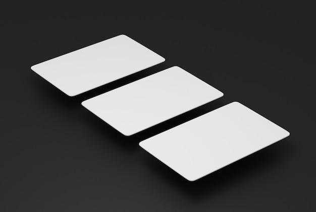 Макет бумажных визитных карточек на сером фоне. 3d визуализации.