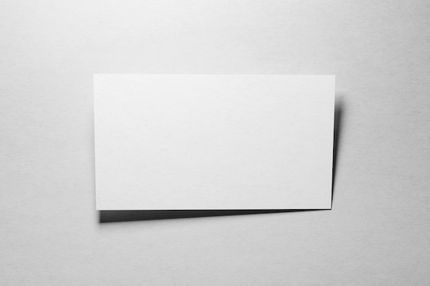 Mockup of one business card at white textured paper background