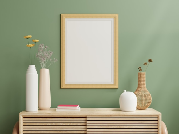Mockup photo frame green wall mounted on the wooden cabinet.3d rendering