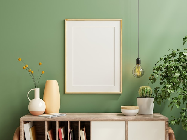 Mockup photo frame green wall mounted on the wooden cabinet with beautiful plants,3d rendering