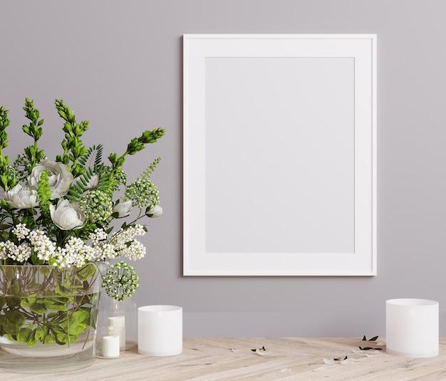 モックアップポスターフレームは、白い花とキャンドルの3dレンダリングでライトグレーの壁にクローズアップ