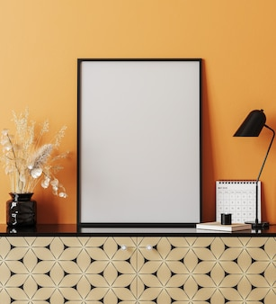 Mockup poster frame in modern interior with orange wall, table lamp, 3d rendering