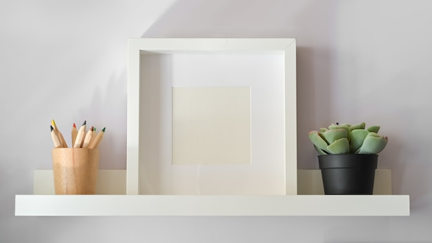 Mockup poster with plant on white shelf