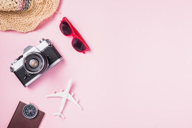 Mockup of retro camera films airplane hat sunglasses starfish beach traveler accessories