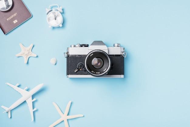 Mockup retro camera films airplane passport starfish shells traveler tropical accessories