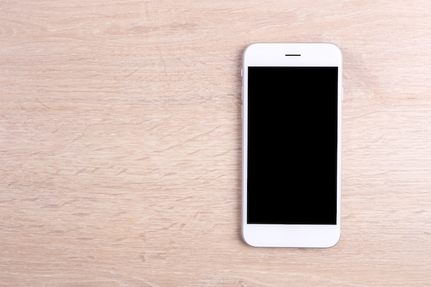 Mockup screen smartphone on wooden background