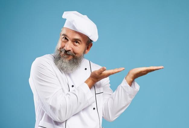 Mockup of senior chef presenting on blue