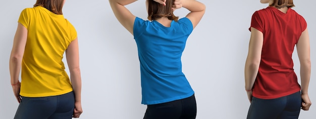 Mockup set with active beautiful woman in the blank  t-shirt isolated on the gray background, includes three color schemes: red, blue, yellow. rear view. template can use for your design or logo.