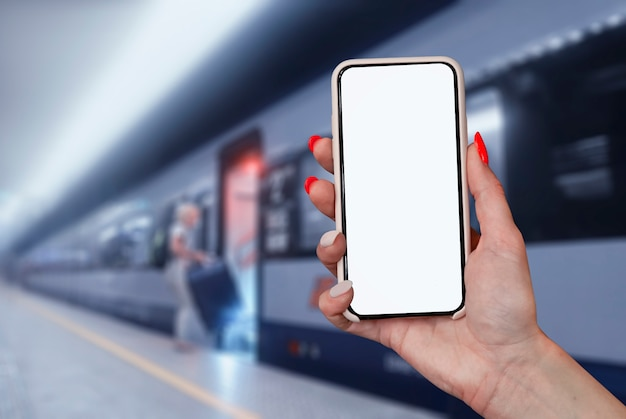 Mockup of a smartphone with a white screen close-up against the background of the train in the subway.