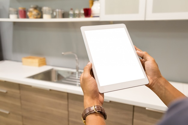 Mockup tablet on businessman hands empty display on home table.