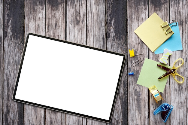 Mockup tablet with blank screen with supplies.