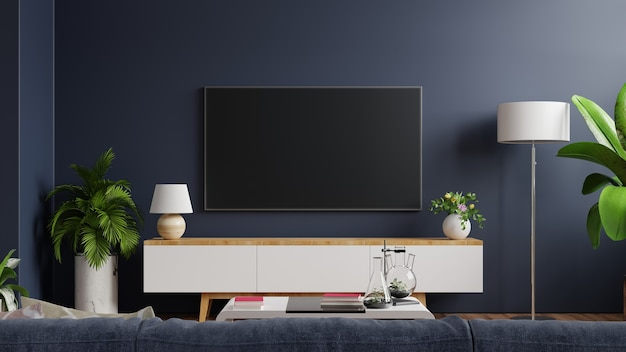 Mockup tv on cabinet in modern empty room with behind the dark blue wall. 3d rendering