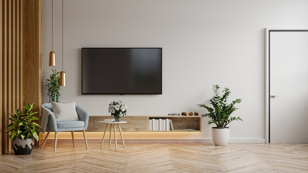 Mockup tv cabinet in modern living room with blue armchair and plant on white wall background,3d rendering